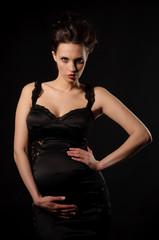 beautiful pregnant woman in black dress