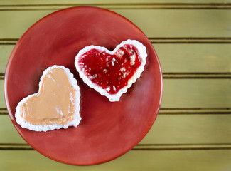 Heart shape peanut butter and jelly sandwtich