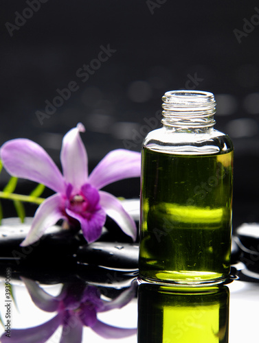 Poster Spa bottles of aromatic oil and fern with orchid