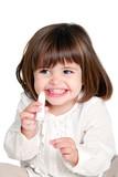 Cute litle girl holding lip balm