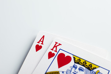 ace and king of hearts on white