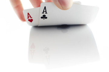 pair of aces on white