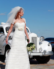 Bride on the background of the wedding car