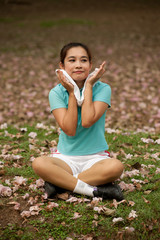 Pretty Thai woman rest exercise in the park .