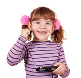 happy little girl play video game and win