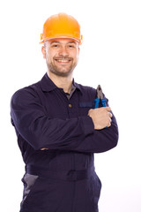 portrait of a young builder with the tools