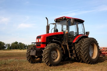 Color photo of a red tractor