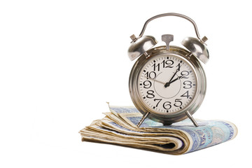 Time for profit - Old clock on stack of banknotes