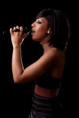 Young black singer performing at concert
