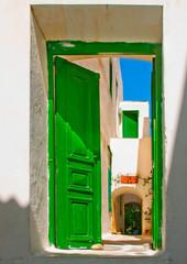 Colored door in old Greek house in Myconos Greece