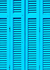 detail of Blue old window in a house of Skiathos island Greece