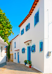 Old house with blue doors  and windows in Skiathos Greece