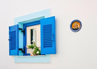 Blue old window in a house of Skiathos island Greece