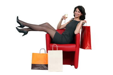 woman with her shopping bags and drinking wine