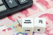 Chinese currency with calculator and dice showing TAKE PROFIT