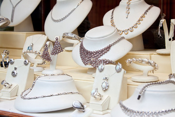 counter with  jewelry in store window