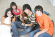 Young people with a guitar