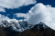 Snowed up mountain range and clouds in Himalayas