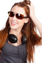 Pretty girl with headphones smiling