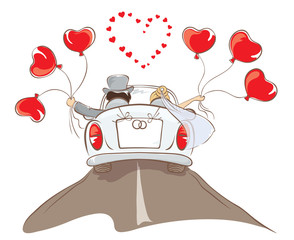 The bride and groom riding in a car