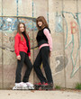 Teenage girls on roller skates posing outdoor
