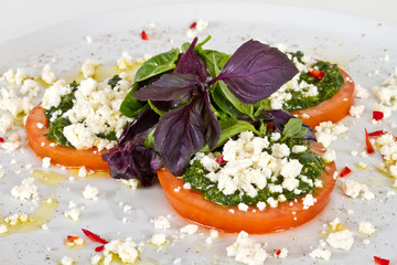 appetizer with tomato,cheese and pesto