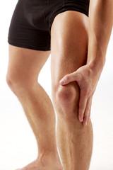 man holding on knee