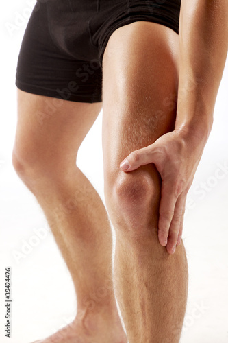 man holding on knee