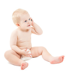 Cute baby boy is talking on cell phone