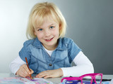 Smiling cute child is painting pictures for art lessons