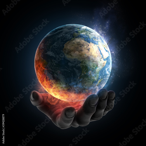 Illustrated hand holding a burning Earth