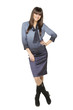 Full length of relaxed young businesswoman standing