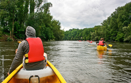 Tourists kayaking on river Dordogne in France