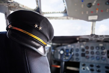 Pilot hat in an airplane