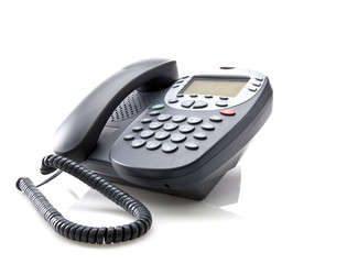 Gray office telephone isolated on a white background