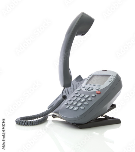 Gray office telephone isolated on a white background with floati