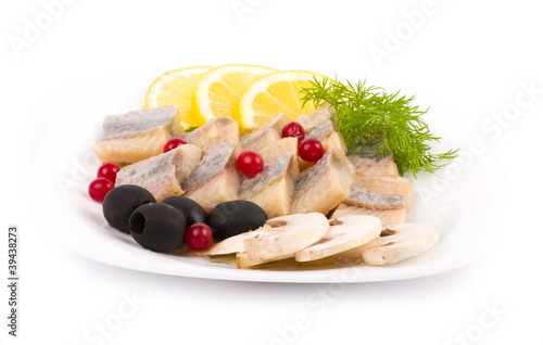 Testy cut herring with vegetable on the plate