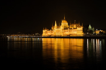night scene with hungarian parliament house, budapest, hungary