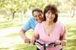 Senior Hispanic couple with bike