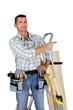 Carpenter stood with step ladder