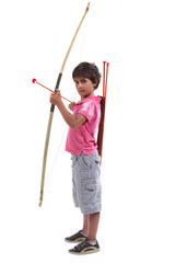 Young boy with a large bow and arrow