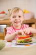 little girl with sandwich