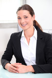 Smiling brunette businesswoman