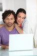 Mixed-race couple at laptop