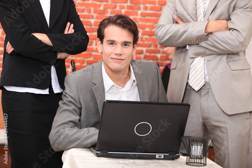Smart young man at a laptop computer