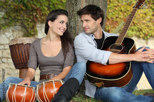 couple playing music in the park
