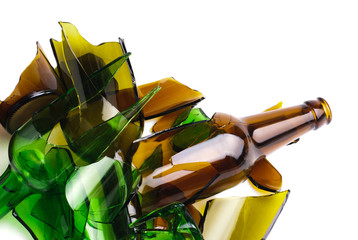 Waste glass.Recycled.Shattered green and brown bottle