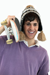 Young man carrying a skateboard