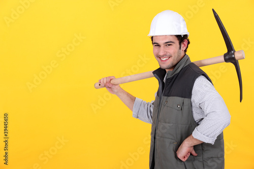 Cheerful man with a pickaxe