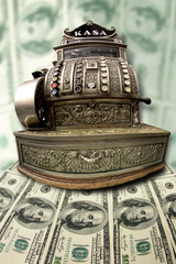 old cash register on the background of the dollars